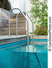 Metal ladder in a swimming pool outdoors