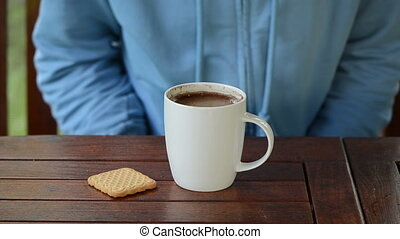 hand coffee cup drink - Hand take cup of steaming hot...