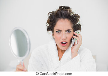 Shocked natural brunette phoning