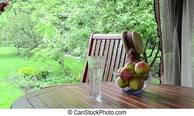 apple fruit woman flower - Apple fruits in glass dish and...