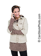 Happy cute brunette in winter fashion phoning