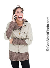 Laughing cute brunette in winter fashion phoning