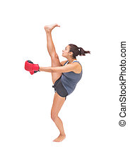 Pretty sporty brunette kick boxing on white background