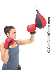 Stern sporty brunette training wit - Stern sporty brunette...