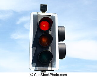 Red Traffic light with blue sky and clouds