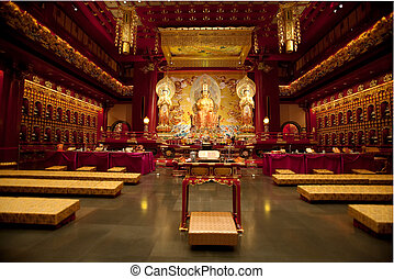Buddhist Temple - Interior of a Buddhist temple with many...