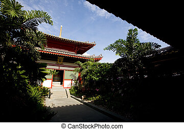 Buddhist Temple - A buddhist temple with a garden and shade
