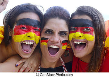 Group of happy german soccer fans commemorating victory -...