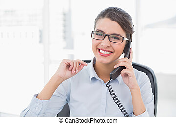 Delighted classy brown haired businesswoman answering the...