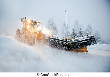 Snow Plow - A snow plow clearing a road in winter