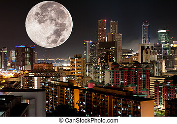 Moon Night City - A very large moon rising over a metropolis