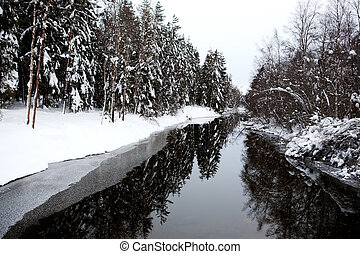 Winter River - A cold winter river with a grey sky