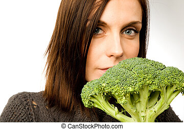 Healthy Eating - A woman with broccoli in hand