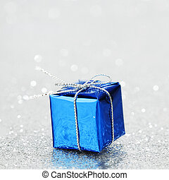 Christmas gift - Blue Christmas gift box on shiny silver...