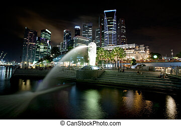 Singapore Cityscape - A view of singapore at night with the...