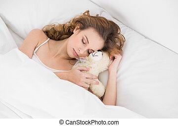 Pretty brunette cuddling teddy bear