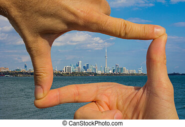 Capturing Toronto - A pair of hands appearing to frame...