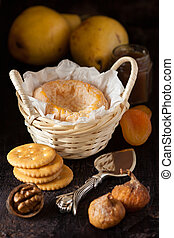Cheese - French cheese Lagres in a basket with dried fruits,...