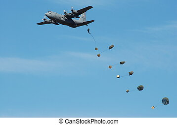 airdop - C130 performing an equipment airdop during an...