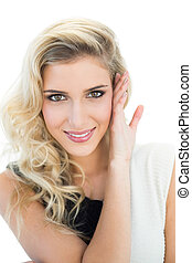 Smiling pretty blonde model looking at camera
