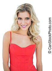 Gorgeous smiling blonde model looking at camera
