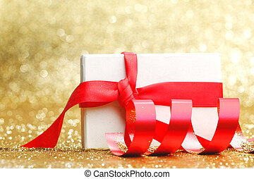 Christmas gift in white box with red ribbon decoration on...