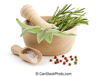 sage and rosemary in the mortar, scoop of coarse salt and...