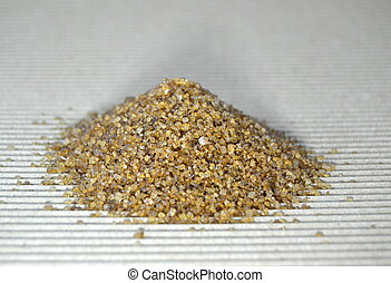 Pile of brown sugar on a table, closeup