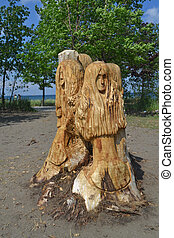 Carved tree part. - The rest of a cut down tree is carved...