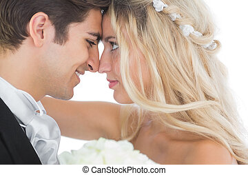 Happy young married couple looking each other in the face on...