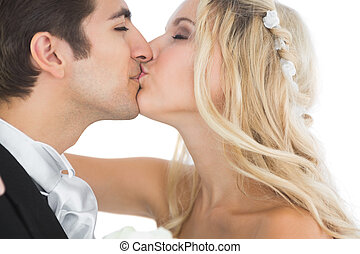 Attractive married couple kissing each other on white...
