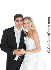 Cheerful cute married couple posing holding hands on white...