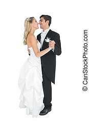 Happy married couple dancing Viennese waltz on white...