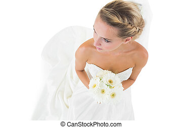High angle view of blonde bride holding a bouquet