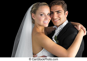 Attractive young couple hugging each other looking at camera