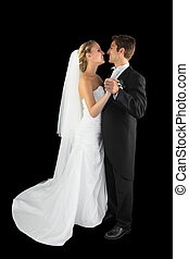 Lovely young young married couple dancing Viennese waltz on...