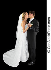 Sweet young married couple dancing Viennese waltz kissing...