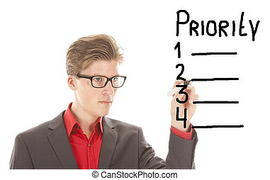 Young man writing priority items isolated on white...
