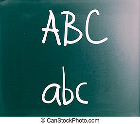 """ABC"" handwritten with white chalk on a blackboard"