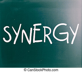 """The word """"Synergy"""" handwritten with white chalk on a blackboard"""