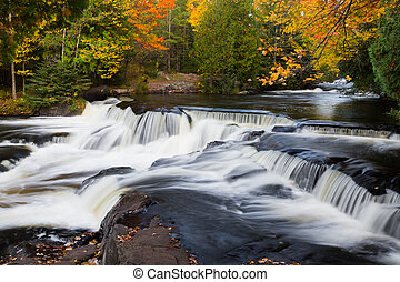 Fall at Upper Bond Falls - Whitewater flows over dark rock...
