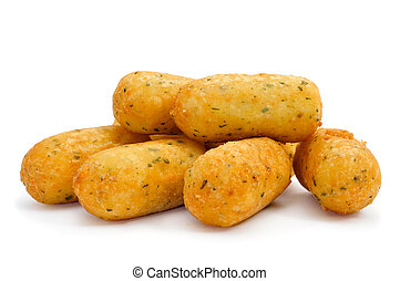 croquetas de bacalao, spanish codfish croquettes - a pile of...