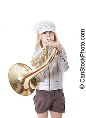 young girl with cap playing french horn