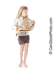 young girl playing french horn