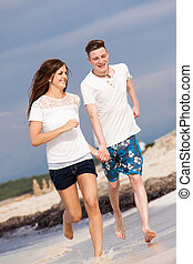 happy young couple on the beach in summer holiday love