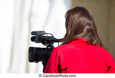 Young cam - Young girl preparing a video report on street