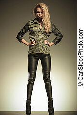 woman in leather pants posing with hands on hips