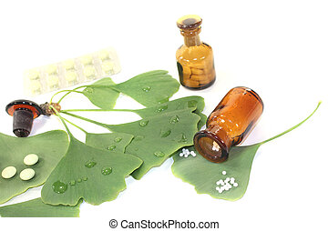 Ginkgo leaf with pills and pharmacist bottle on bright...