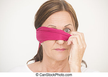 One eye blindfolded woman - Portrait attractive mature woman...