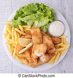 fish and chips with salad and sauce